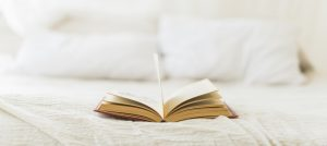open hardcover book on bed at home copia min e1604789455312